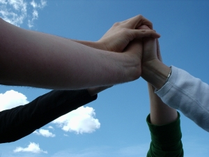 Hands join against the sky