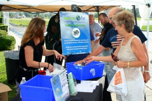 Citizens recycle old phones and chargers at the Easy As One event.