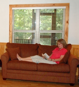 Woman on couch reading