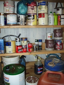 shelves with common household hazardous waste, such as paints